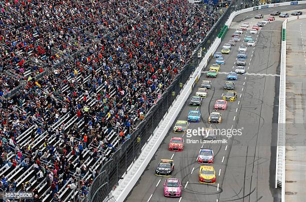 Joey Logano driver of the Shell Pennzoil Ford and Martin Truex Jr driver of the Furniture Row/Visser Precision Chevrolet follow the pace car down the...