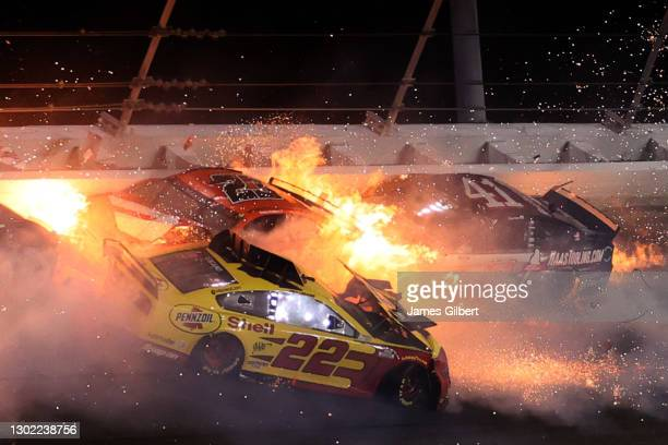 Joey Logano, driver of the Shell Pennzoil Ford, Bubba Wallace, driver of the DoorDash Toyota, and Cole Custer, driver of the HaasTooling.com Ford,...