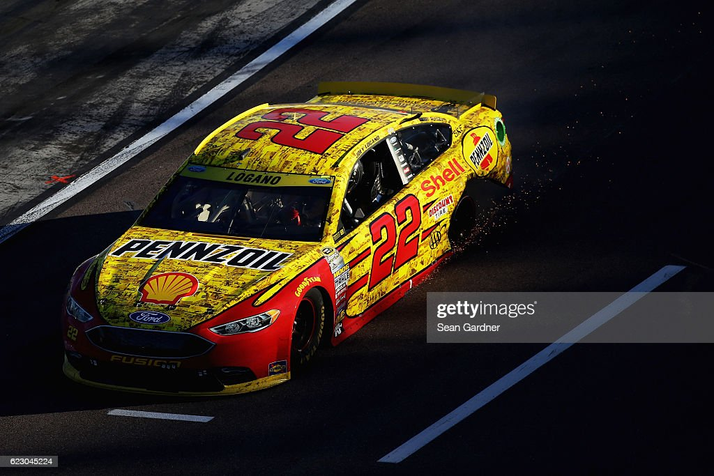 Joey Logano, driver of the #22 Shell Pennzoil Ford, celebrates after blowing a tire during a burnout following the NASCAR Sprint Cup Series Can-Am 500 at Phoenix International Raceway on November 13, 2016 in Avondale, Arizona.