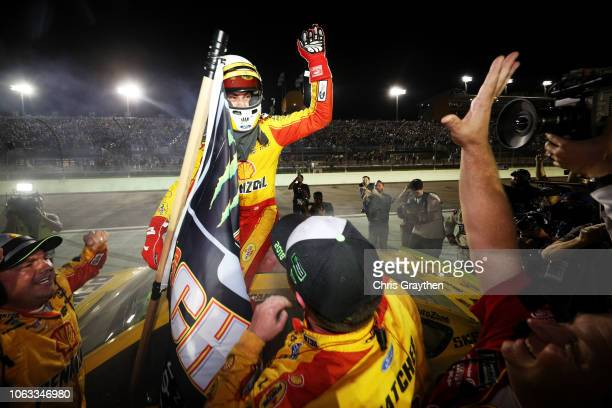 Joey Logano driver of the Shell Pennzoil Ford celebrates after winning the Monster Energy NASCAR Cup Series Ford EcoBoost 400 and the Monster Energy...