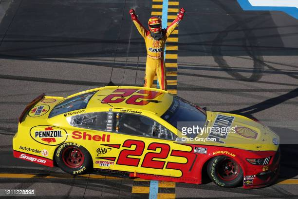 Joey Logano, driver of the Shell Pennzoil Ford, celebrates after winning the NASCAR Cup Series FanShield 500 at Phoenix Raceway on March 08, 2020 in...