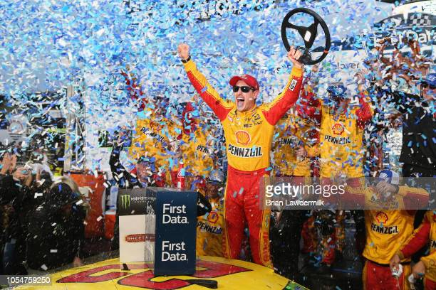 Joey Logano, driver of the Shell Pennzoil Ford, celebrates in Victory Lane after winning the Monster Energy NASCAR Cup Series First Data 500 at...
