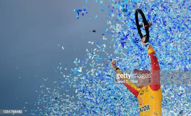 Joey Logano driver of the Shell Pennzoil Ford celebrates in Victory Lane after winning the Monster Energy NASCAR Cup Series First Data 500 at...