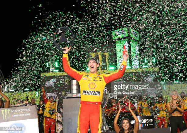 Joey Logano, driver of the Shell Pennzoil Ford, celebrates in victory lane after winning the Monster Energy NASCAR Cup Series Ford EcoBoost 400 and...