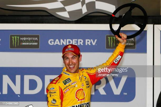 Joey Logano driver of the Shell Pennzoil Ford celebrates in victory lane after winning the Monster Energy NASCAR Cup Series Gander RV Duel At DAYTONA...
