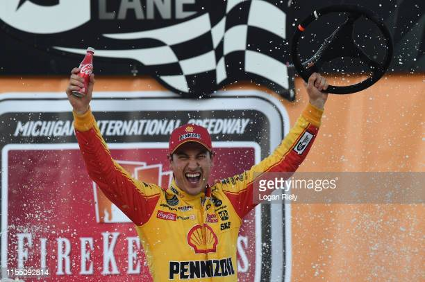 Joey Logano driver of the Shell Pennzoil Ford celebrates in Victory Lane after winning the Monster Energy NASCAR Cup Series FireKeepers Casino 400 at...