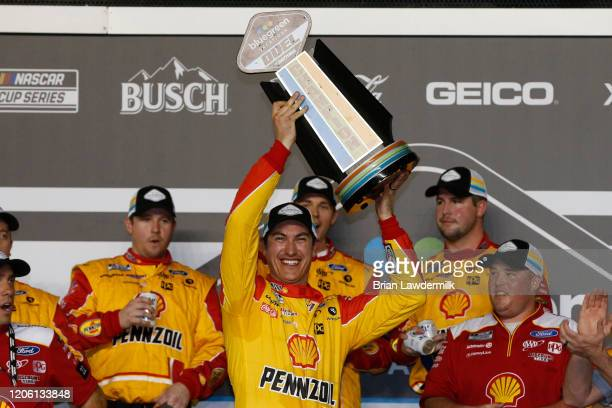 Joey Logano, driver of the Shell Pennzoil Ford, celebrates in Victory Lane after winning the NASCAR Cup Series Bluegreen Vacations Duel 1 at Daytona...