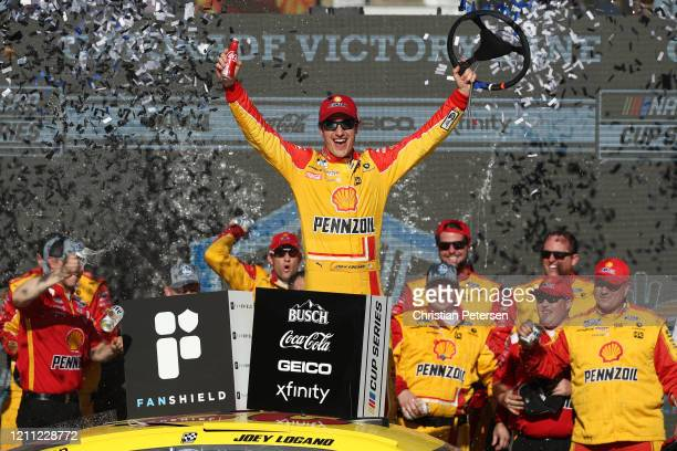 Joey Logano, driver of the Shell Pennzoil Ford, celebrates in Victory Lane after winning the NASCAR Cup Series FanShield 500 at Phoenix Raceway on...