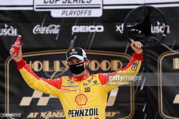 Joey Logano, driver of the Shell Pennzoil Ford, celebrates in Victory Lane after winning the NASCAR Cup Series Hollywood Casino 400 at Kansas...