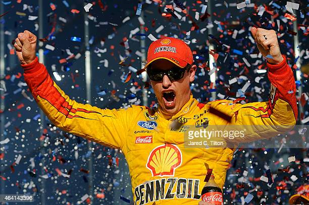Joey Logano, driver of the Shell Pennzoil Ford, celebrates in victory lane after winning the NASCAR Sprint Cup Series 57th Annual Daytona 500 at...