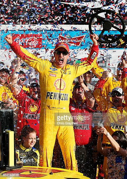 Joey Logano driver of the Shell Pennzoil Ford celebrates in victory lane after winning the NASCAR Sprint Cup Series 57th Annual Daytona 500 at...