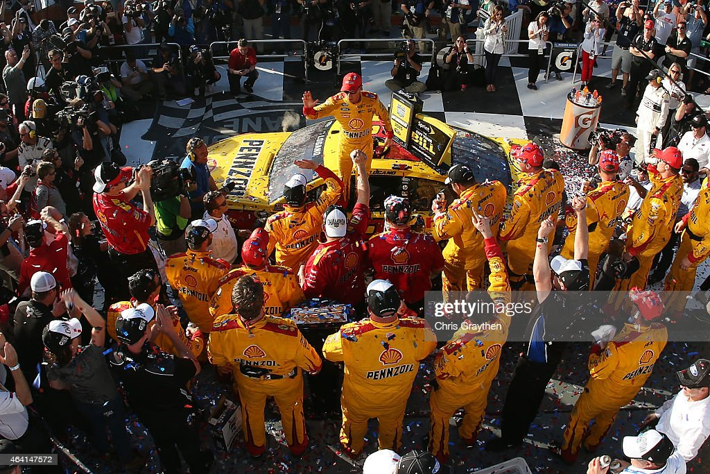 Joey Logano, driver of the #22 Shell Pennzoil Ford, celebrates in victory lane after winning the NASCAR Sprint Cup Series 57th Annual Daytona 500 at Daytona International Speedway on February 22, 2015 in Daytona Beach, Florida.