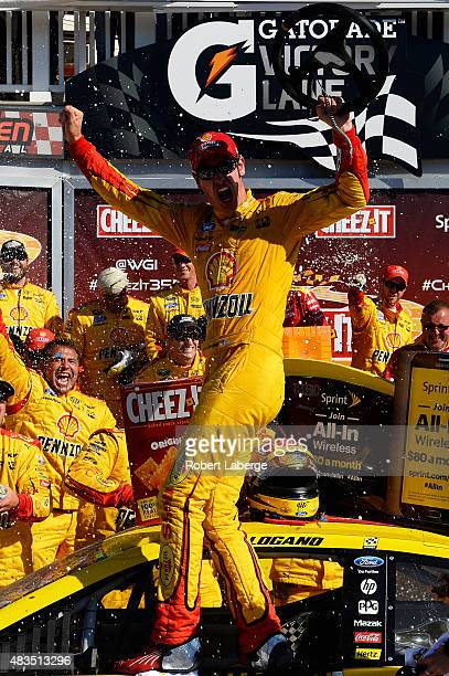 Joey Logano driver of the Shell Pennzoil Ford celebrates in victory lane after winning the NASCAR Sprint Cup Series CheezIt 355 at the Glen at...