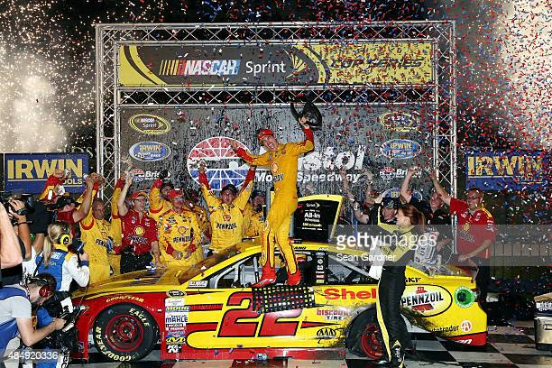 Joey Logano driver of the Shell Pennzoil Ford celebrates in Victory Lane after winning the NASCAR Sprint Cup Series IRWIN Tools Night Race at Bristol...