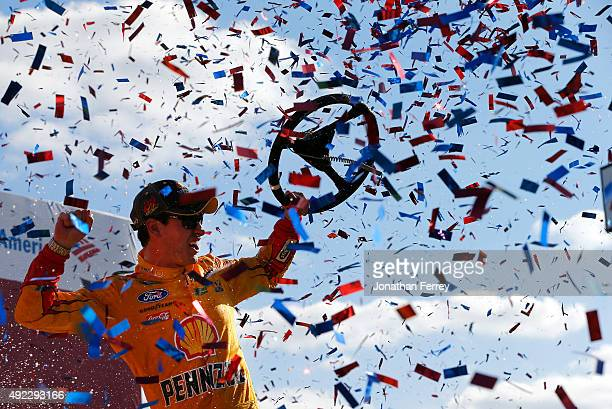Joey Logano, driver of the Shell Pennzoil Ford, celebrates in Victory Lane after winning the NASCAR Sprint Cup Series Bank of America 500 at...
