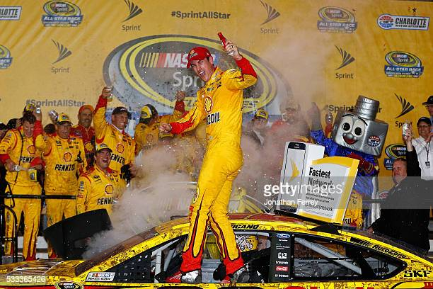 Joey Logano driver of the Shell Pennzoil Ford celebrates in Victory Lane after winning the NASCAR Sprint Cup Series Sprint AllStar Race at Charlotte...