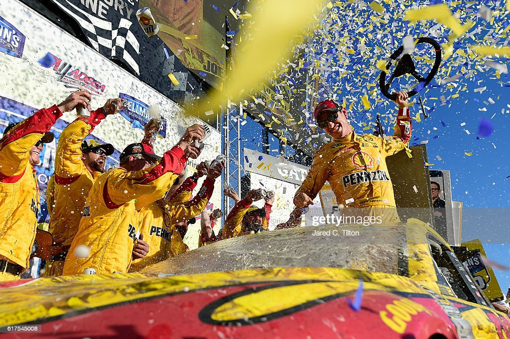 Joey Logano, driver of the #22 Shell Pennzoil Ford, celebrates in Victory Lane after winning the NASCAR Sprint Cup Series Hellmann's 500 at Talladega Superspeedway on October 23, 2016 in Talladega, Alabama.