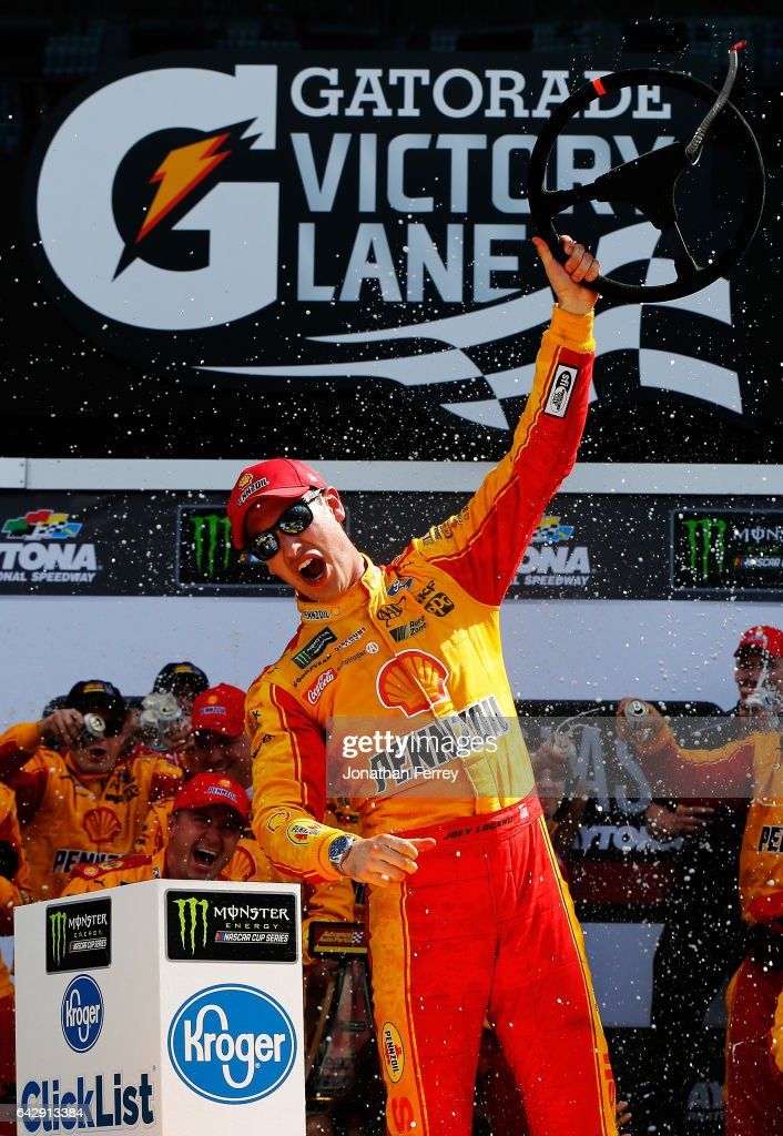 Joey Logano, driver of the #22 Shell Pennzoil Ford, celebrates in victory lane after winning the weather delayed Monster Energy NASCAR Cup Series Advance Auto Parts Clash at Daytona International Speedway on February 19, 2017 in Daytona Beach, Florida.