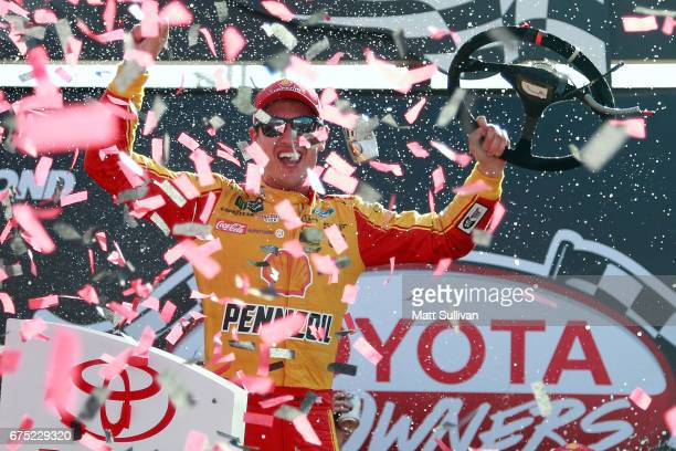 Joey Logano driver of the Shell Pennzoil Ford celebrates in Victory Lane after winning the Monster Energy NASCAR Cup Series Toyota Owners 400 at...