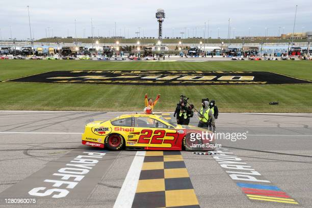 Joey Logano, driver of the Shell Pennzoil Ford, celebrates winning the NASCAR Cup Series Hollywood Casino 400 at Kansas Speedway on October 18, 2020...