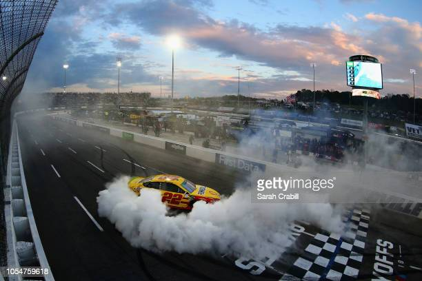 Joey Logano driver of the Shell Pennzoil Ford celebrates with a burnout after winning the Monster Energy NASCAR Cup Series First Data 500 at...