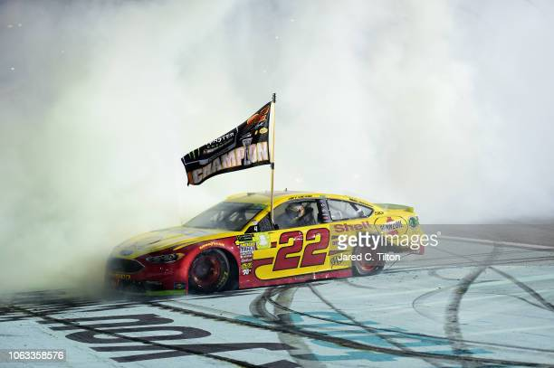 Joey Logano driver of the Shell Pennzoil Ford celebrates with a burnout after winning the Monster Energy NASCAR Cup Series Ford EcoBoost 400 at...