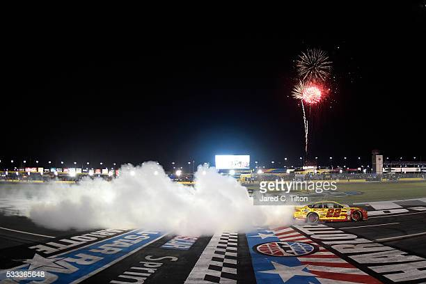 Joey Logano driver of the Shell Pennzoil Ford celebrates with a burnout after winning the NASCAR Sprint Cup Series Sprint AllStar Race at Charlotte...