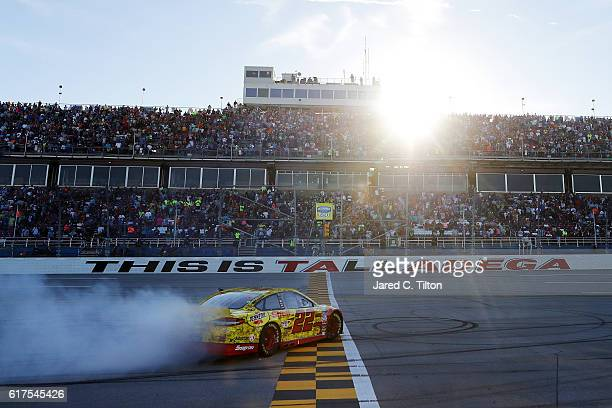 Joey Logano driver of the Shell Pennzoil Ford celebrates with a burnout after winning the NASCAR Sprint Cup Series Hellmann's 500 at Talladega...
