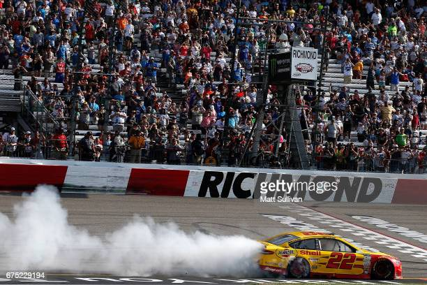 Joey Logano driver of the Shell Pennzoil Ford celebrates with a burnout after winning the Monster Energy NASCAR Cup Series Toyota Owners 400 at...