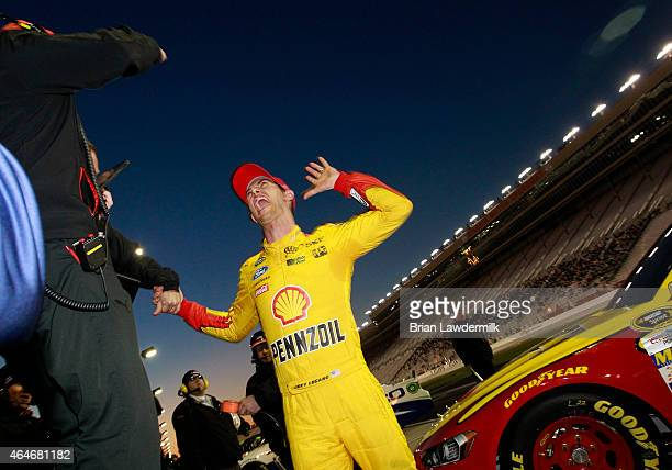 Joey Logano, driver of the Shell Pennzoil Ford, celebrates with crew members after qualifying for the pole position for the NASCAR Sprint Cup Series...