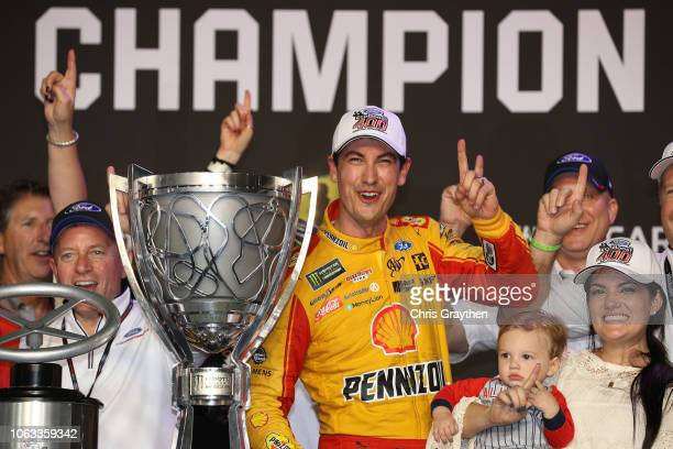 Joey Logano, driver of the Shell Pennzoil Ford, celebrates with his wife, Brittany, and son, Hudson, after winning the Monster Energy NASCAR Cup...
