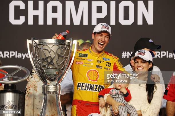 Joey Logano driver of the Shell Pennzoil Ford celebrates with his wife Brittany and son Hudson after winning the Monster Energy NASCAR Cup Series...
