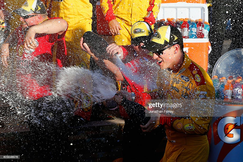 Joey Logano, driver of the #22 Shell Pennzoil Ford, celebrates with champagne in Victory Lane the NASCAR Sprint Cup Series Can-Am 500 at Phoenix International Raceway on November 13, 2016 in Avondale, Arizona.