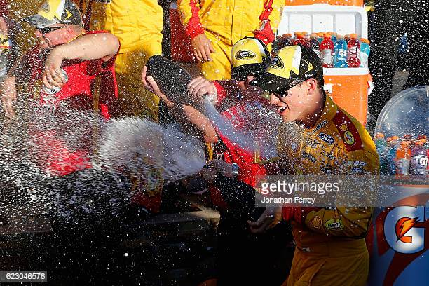 Joey Logano driver of the Shell Pennzoil Ford celebrates with champagne in Victory Lane the NASCAR Sprint Cup Series CanAm 500 at Phoenix...