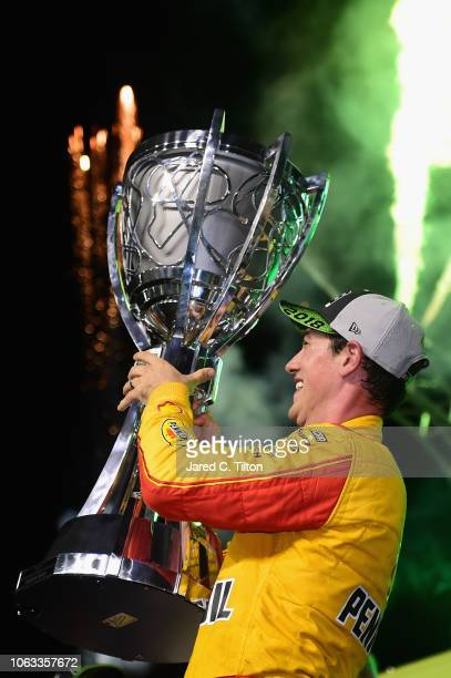 Joey Logano driver of the Shell Pennzoil Ford celebrates with the trophy after winning the Monster Energy NASCAR Cup Series Ford EcoBoost 400 at...