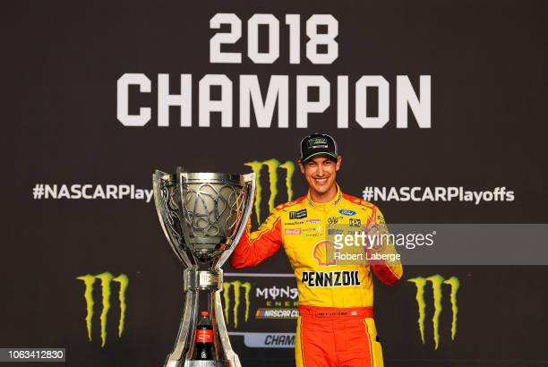 Joey Logano driver of the Shell Pennzoil Ford celebrates with the trophy after winning the Monster Energy NASCAR Cup Series Ford EcoBoost 400 and the...