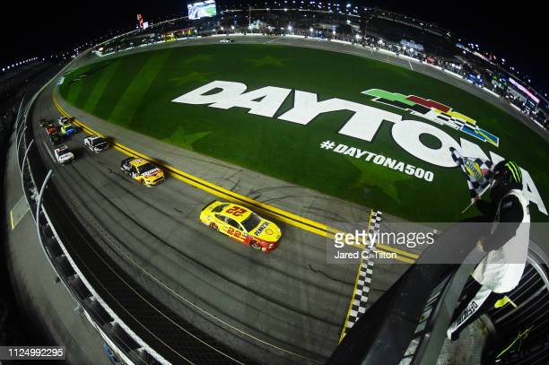 Joey Logano driver of the Shell Pennzoil Ford crosses the finish line to win the Monster Energy NASCAR Cup Series Gander RV Duel At DAYTONA at...