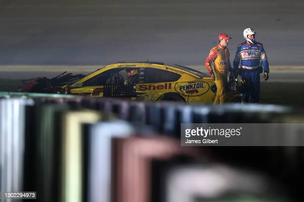 Joey Logano, driver of the Shell Pennzoil Ford, is assisted by the NASCAR Safety crew after an on-track incident during the NASCAR Cup Series 63rd...