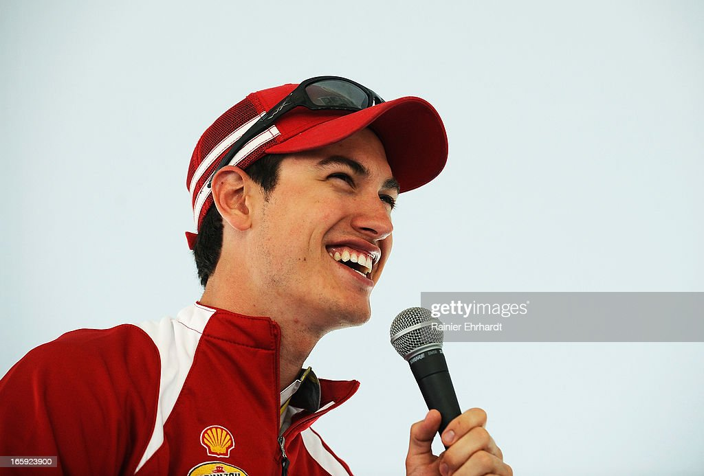 Joey Logano, driver of the #22 Shell Pennzoil Ford, laughs during a fan appearance before the NASCAR Sprint Cup Series STP Gas Booster 500 on April 7, 2013 at Martinsville Speedway in Ridgeway, Virginia.