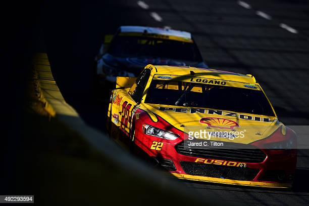 Joey Logano driver of the Shell Pennzoil Ford leads Kevin Harvick driver of the Jimmy John's/Budweiser Chevrolet during the NASCAR Sprint Cup Series...