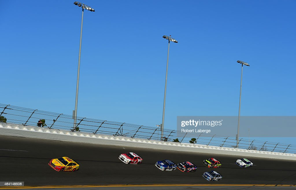 Joey Logano, driver of the #22 Shell Pennzoil Ford, leads the field during the NASCAR Sprint Cup Series 57th Annual Daytona 500 at Daytona International Speedway on February 22, 2015 in Daytona Beach, Florida.