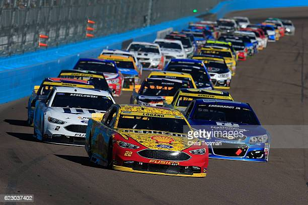 Joey Logano driver of the Shell Pennzoil Ford leads the field in a restart during the NASCAR Sprint Cup Series CanAm 500 at Phoenix International...