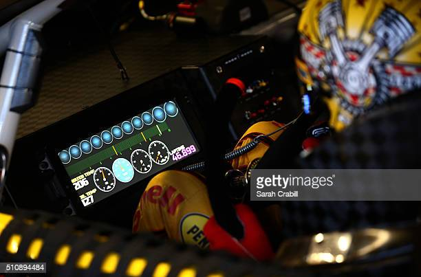 Joey Logano driver of the Shell Pennzoil Ford looks at his digital dashboard during practice for the Daytona 500 at Daytona International Speedway on...