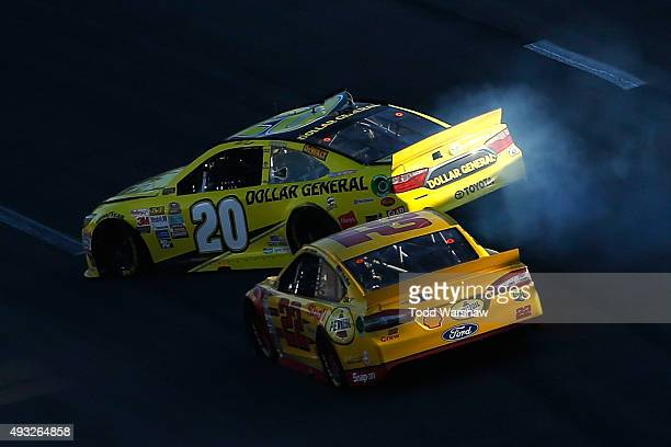 Joey Logano driver of the Shell Pennzoil Ford makes contact with Matt Kenseth driver of the Dollar General Toyota during the NASCAR Sprint Cup Series...