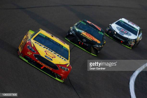 Joey Logano driver of the Shell Pennzoil Ford Martin Truex Jr driver of the Bass Pro Shops/5hour ENERGY Toyota and Kevin Harvick driver of the Jimmy...