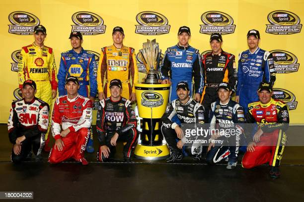 Joey Logano, driver of the Shell Pennzoil Ford, Martin Truex Jr., driver of the NAPA Auto Parts Toyota, Kyle Busch, driver of the M&M's American...