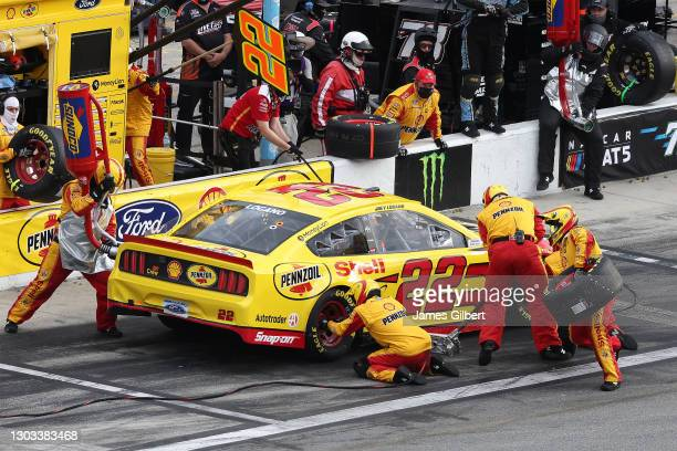Joey Logano, driver of the Shell Pennzoil Ford, pits during the NASCAR Cup Series O'Reilly Auto Parts 253 at Daytona International Speedway on...