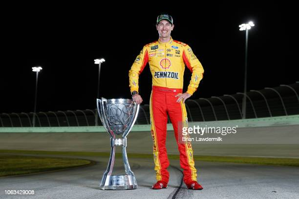 Joey Logano driver of the Shell Pennzoil Ford poses for a photo after winning the Monster Energy NASCAR Cup Series Ford EcoBoost 400 and the Monster...