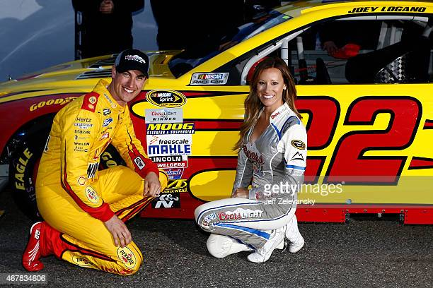 Joey Logano driver of the Shell Pennzoil Ford poses with Miss Coors Light Rachel Rupert after winning the Coors Light Pole Award for the NASCAR...