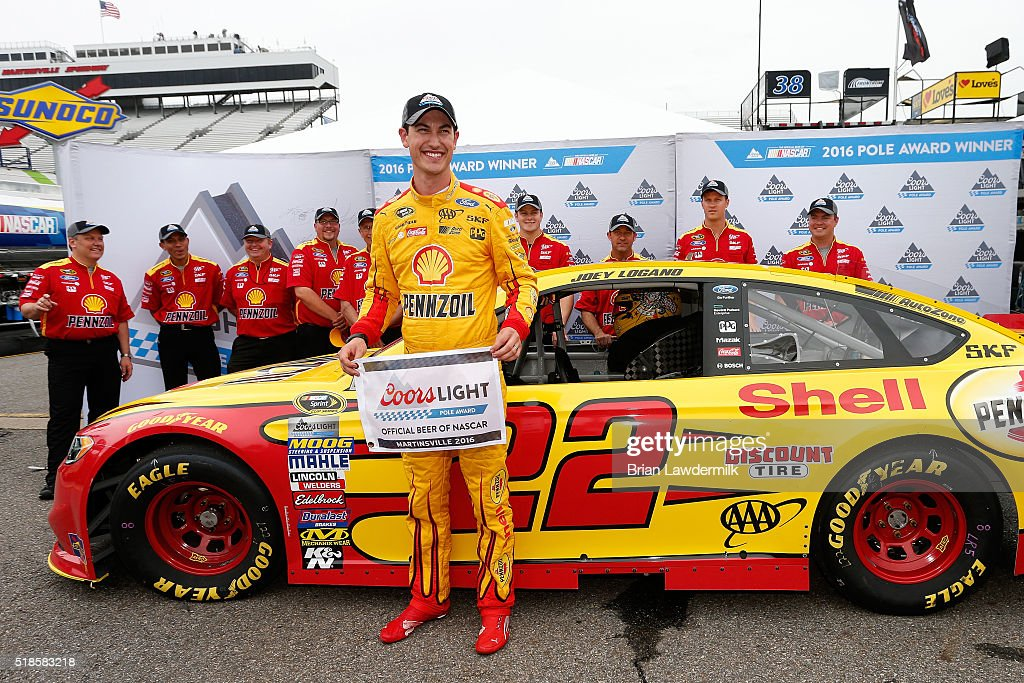 Joey Logano, driver of the #22 Shell Pennzoil Ford, poses with the Coors Light Pole Award after qualifying for pole position for the NASCAR Sprint Cup Series STP 500 at Martinsville Speedway on April 1, 2016 in Martinsville, Virginia.